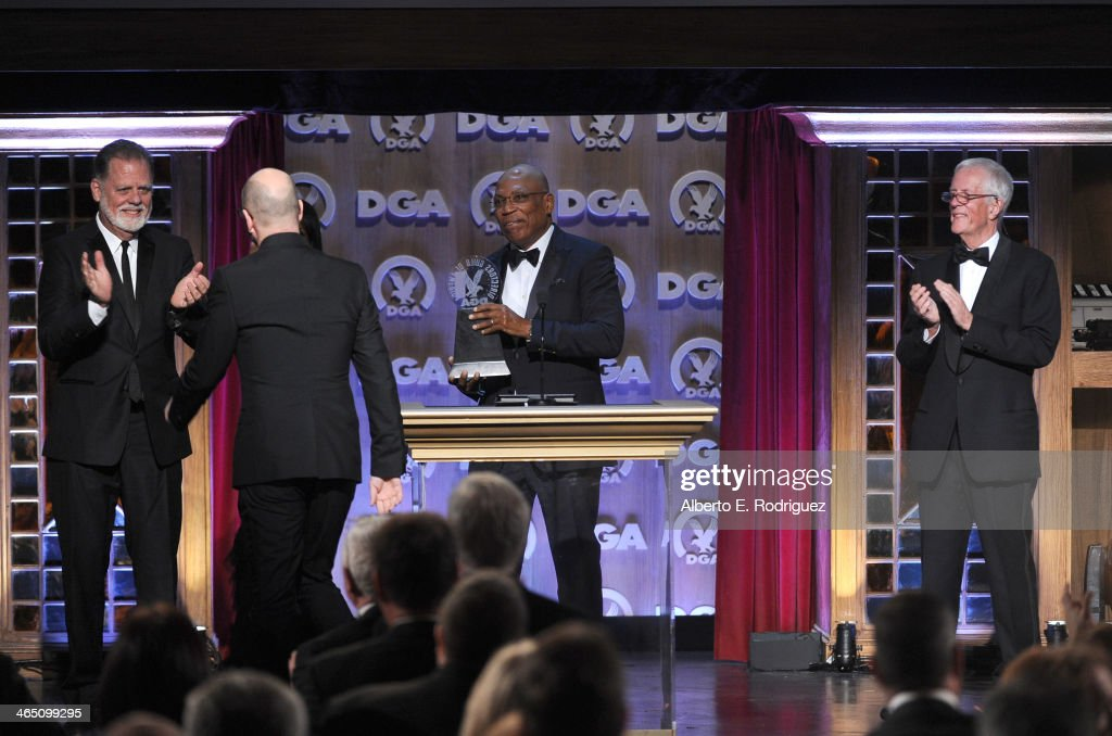 Director Taylor Hackford, Director Steven Soderbergh accepting the Robert B. Aldrich Service Award, DGA President Paris Barclay and Michael Apted onstage at the 66th Annual Directors Guild Of America Awards held at the Hyatt Regency Century Plaza on January 25, 2014 in Century City, California.