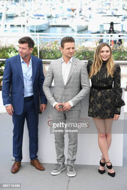 Director Taylor Sheridan and actors Jeremy Renner and Elizabeth Olsen attend the 'Wind River' photocall during the 70th annual Cannes Film Festival...