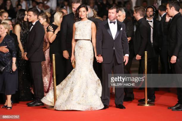 US director Taylor Sheridan and his wife Nicole Sheridan arrive on May 20 2017 for the screening of the film 'Wind River' at the 70th edition of the...