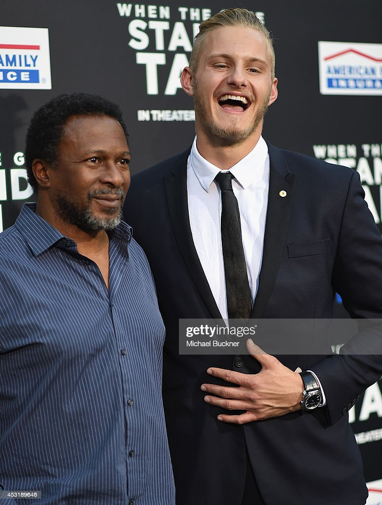 Director Thomas Carter (L) and actor Alexander Ludwig arrive at the premire of Tri Star Pictures' ' When The Game Stands Tall' at the ArcLight Cinemas on August 4, 2014 in Hollywood, California.