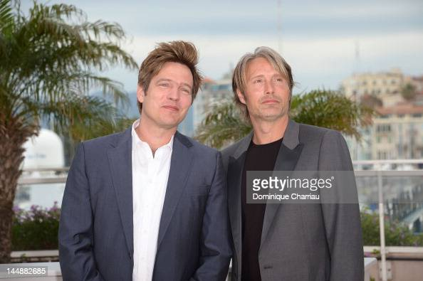 Director Thomas Vinterberg and actor Mads Mikkelsen attend the 'Jagten' Photocall during the 65th Annual Cannes Film Festival at Palais des Festivals...