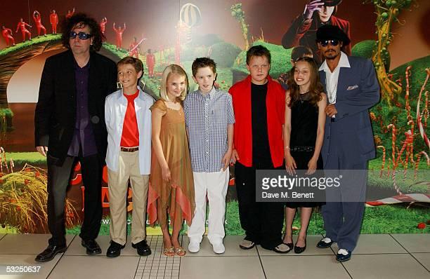 Director Tim Burton actors Jordan Fry Annasophia Robb Freddie Highmore Phillip Wiegratz Julia Winter and Johnny Depp arrive at the UK Premiere of...