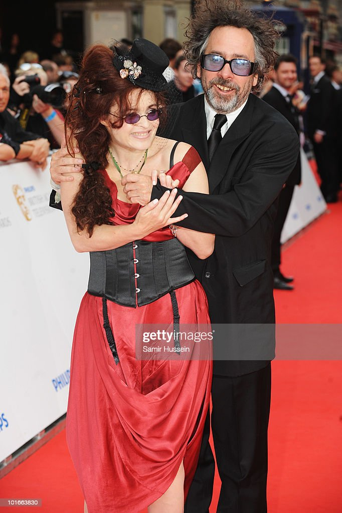 Director Tim Burton and his wife Helena Bonham Carter arrive for the Philips British Academy Television Awards at the London Palladium on June 6 2010...