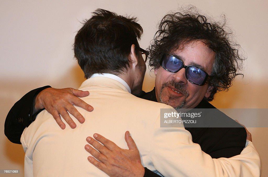 US director Tim Burton (R) hugues US actor Johnny Deep before receiving a Golden Lion for lifetime achievement during the 64th Venice International Film Festival at Venice Lido 05 September 2007.