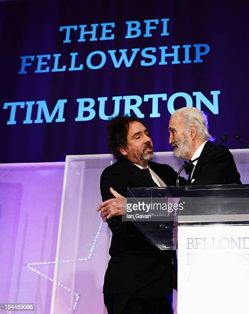 Director Tim Burton receives the BFI Fellowship award from Sir Christopher Lee during the 56th BFI London Film Festival Awards at the Banqueting...