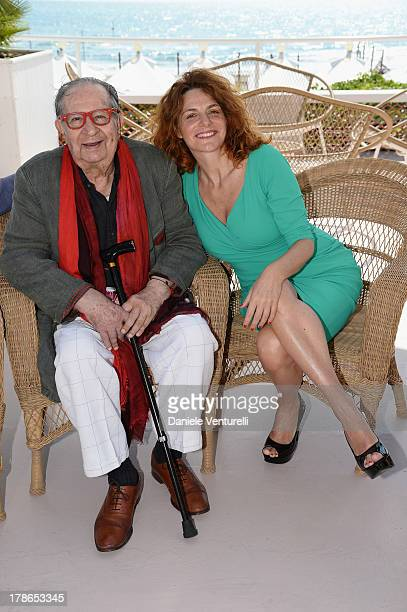 Director Tinto Brass and actress Caterina Varzi are seen during the 70th Venice International Film Festival on August 30 2013 in Venice Italy