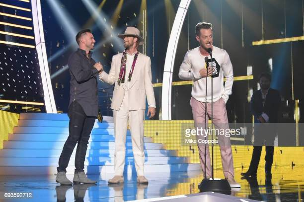 Director TK McKamy Brian Kelley and Tyler Hubbard accept an award onstage during the 2017 CMT Music Awards at the Music City Center on June 6 2017 in...