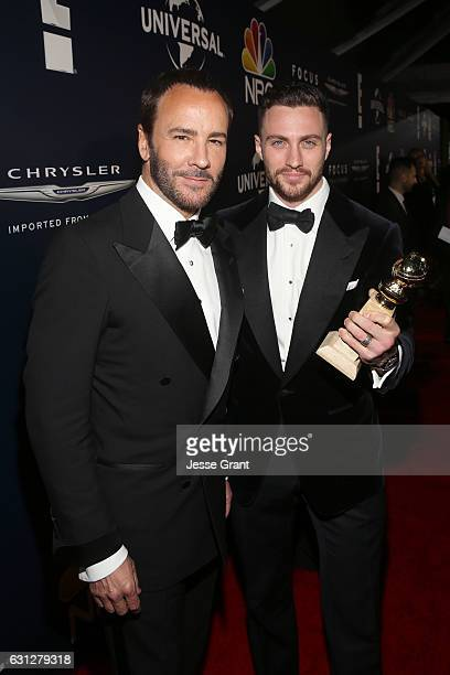 Director Tom Ford and actor Aaron TaylorJohnson winner of Best Supporting Actor in a Motion Picture for 'Nocturnal Animals' attend the Universal NBC...