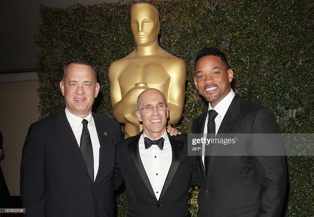 Director Tom Hanks, Jeffrey Katzenberg and actor Will Smith arrive at the 2012 Governors Awards at the Ray Dolby Ballroom at Hollywood & Highland Center in Hollywood, California on December 1, 2012. The Board of Governors of the Academy of Motion Picture Arts and Sciences (AMPAS) is presenting the Jean Hersholt Humanitarian Award to Jeffery Katzenberg, and Honorary Awards to stunt performer Hal Needham, documentarian D.A. Pennebaker and arts advocate George Stevens Jr.at the inaugural Governors Awards event. AFP PHOTO / Krista KENNELL