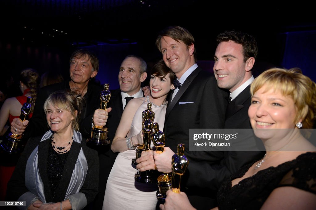 Director <a gi-track='captionPersonalityLinkClicked' href=/galleries/search?phrase=Tom+Hooper&family=editorial&specificpeople=681836 ng-click='$event.stopPropagation()'>Tom Hooper</a> (3rd from R), Actress <a gi-track='captionPersonalityLinkClicked' href=/galleries/search?phrase=Anne+Hathaway+-+Actrice&family=editorial&specificpeople=11647173 ng-click='$event.stopPropagation()'>Anne Hathaway</a> (C) , winner of the Best Supporting Actress, Sound engineers Andy Nelson (2nd from L), Simon Hayes (3rd from R) and Mark Paterson (2nd from L), winners of the Best Sound Mixing, Makeup artists Lisa Westcott (L) and Julie Dartnell (R), winners of the Best Makeup and Hairstyling for 'Les Miserables' attend the Oscars Governors Ball at Hollywood & Highland Center on February 24, 2013 in Hollywood, California.