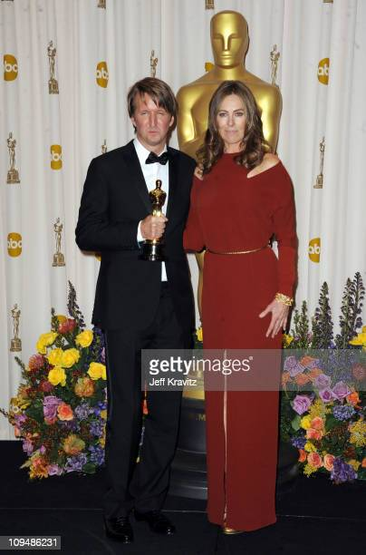 Director Tom Hooper and presenter Kathryn Bigelow pose in the press room during the 83rd Annual Academy Awards held at the Kodak Theatre on February...