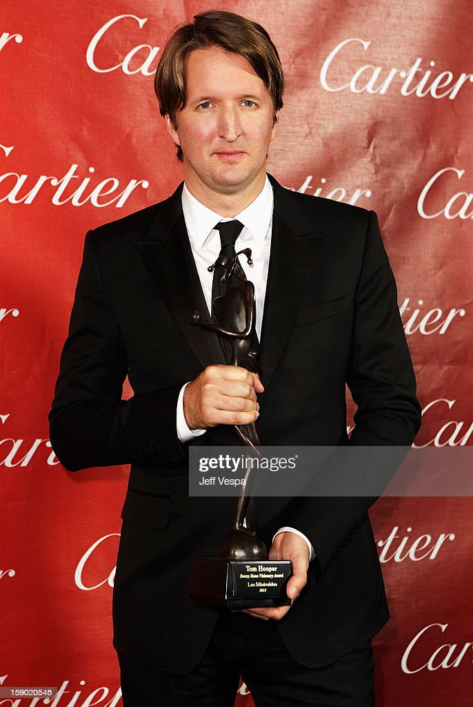 Director Tom Hooper poses with the Sonny Bono Visionary Award during the 24th annual Palm Springs International Film Festival Awards Gala at the Palm Springs Convention Center on January 5, 2013 in Palm Springs, California.