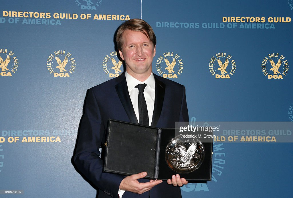 "Director <a gi-track='captionPersonalityLinkClicked' href=/galleries/search?phrase=Tom+Hooper&family=editorial&specificpeople=681836 ng-click='$event.stopPropagation()'>Tom Hooper</a>, recipient of the Feature Film Nomination Plaque for ""Les Miserables,' poses in the press room during the 65th Annual Directors Guild Of America Awards at Ray Dolby Ballroom at Hollywood & Highland on February 2, 2013 in Los Angeles, California."