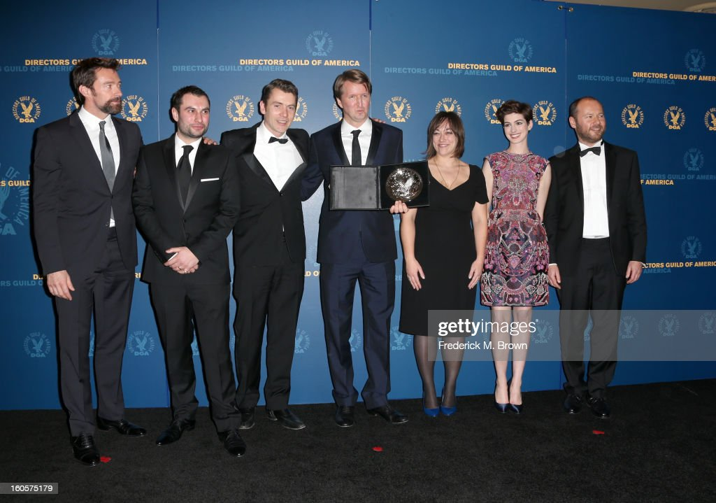 """Director Tom Hooper (C), recipient of the Feature Film Nomination Plaque for """"Les Miserables,' poses in the press room during the 65th Annual Directors Guild Of America Awards at Ray Dolby Ballroom at Hollywood & Highland on February 2, 2013 in Los Angeles, California."""