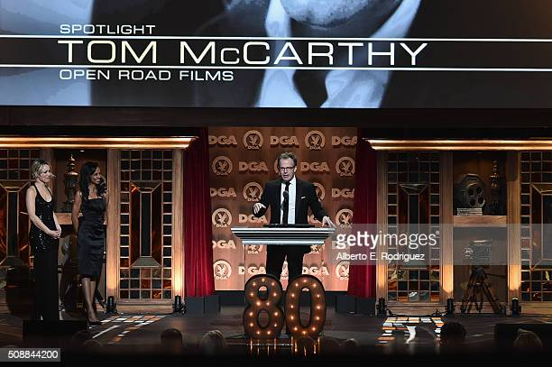 "Director Tom McCarthy accepts the Feature Film Nomination Plaque for ""Spotlight"" from actress Rachel McAdams onstage at the 68th Annual Directors..."
