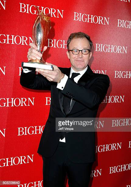 Director Tom McCarthy poses with the Sonny Bono Visionary Award during the 27th Annual Palm Springs International Film Festival Awards Gala at Palm...