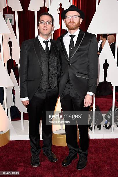 Director Tom Moore and producer Paul Young attend the 87th Annual Academy Awards at Hollywood Highland Center on February 22 2015 in Hollywood...