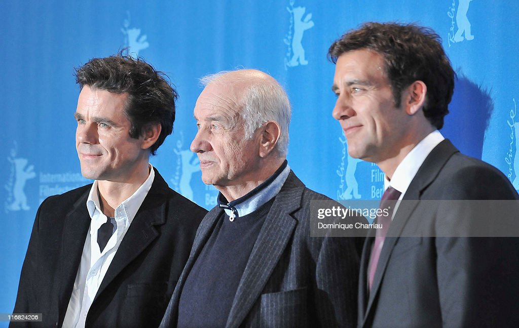 Director Tom Tykwer actors Armin MuellerStahl and Clive Owen attend the photocall for 'The International' as part of the 59th Berlin Film Festival at...