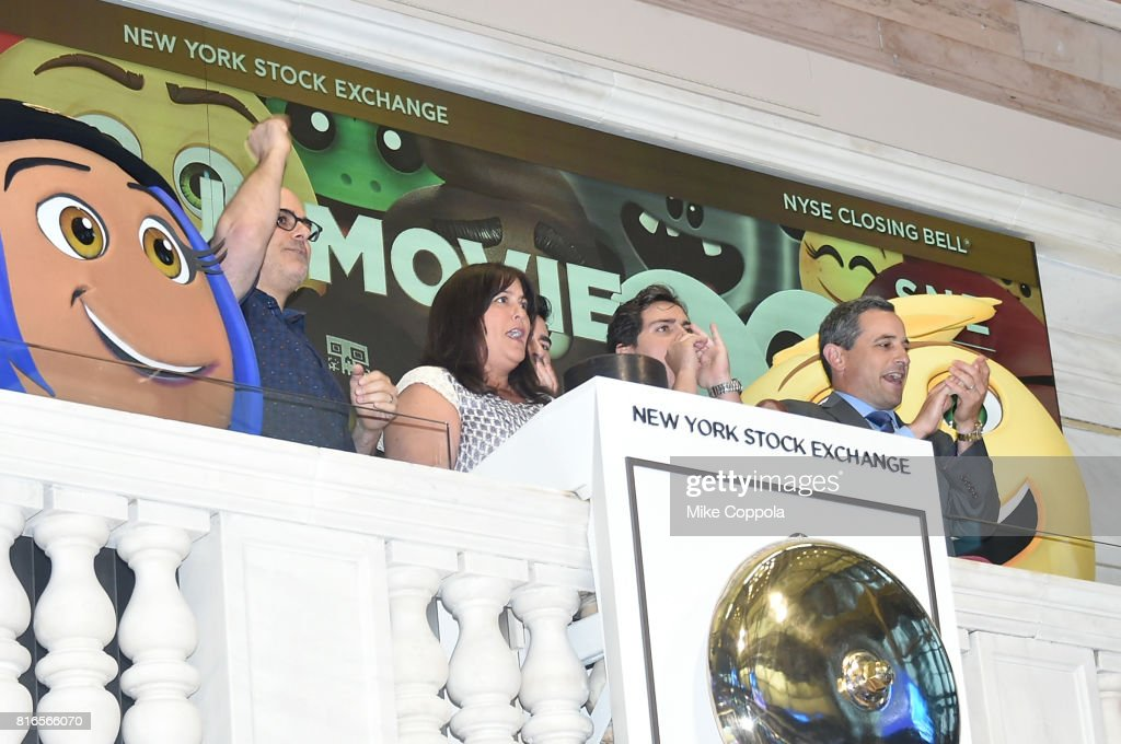 Director Tony Leondis, Producer Michelle Raimo Kouyate, Actor Jake T. Austin and Vice President of the NYSE Listings and NYSE Services Chris Taylor ring The Closing Bell Of The New York Stock Exchange In Honor Of World Emoji Day at New York Stock Exchange on July 17, 2017 in New York City.