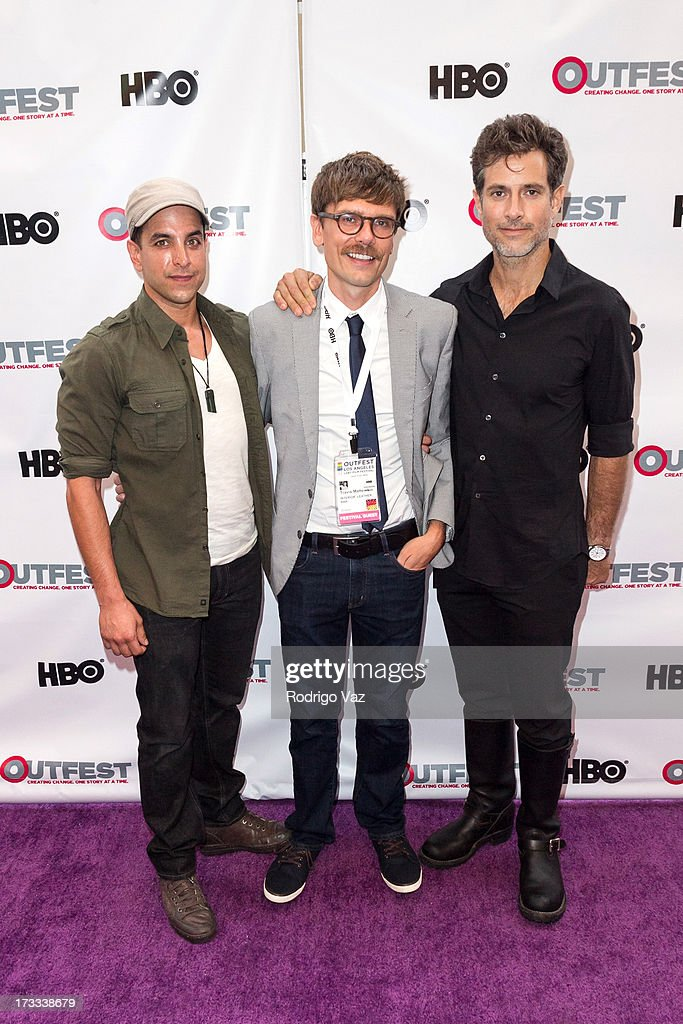 Director Travis Matthews (C) arrives at the 13th Annual Outfest Opening Night Gala Of 'C.O.G.' at Orpheum Theatre on July 11, 2013 in Los Angeles, California.