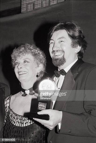 Director Trevor Nunn holds the Tony Award he won for directing the musical Les Miserables