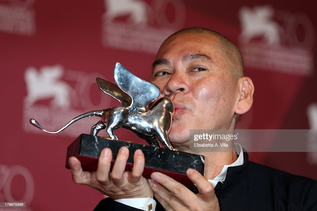 Director Tsai Ming-liang poses with the Grand Jury Prize he received for his movie 'Jiaoyou' as he attends the Award Winners Photocall during the 70th Venice International Film Festival at Palazzo del Casino on September 7, 2013 in Venice, Italy.
