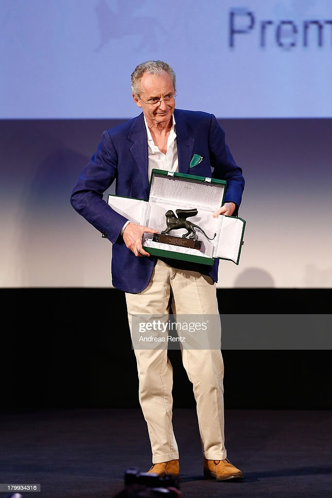 Director Uberto Pasolini poses onstage with the Orizzonti Award for Best Director he received for his movie 'Still Life' during the Closing Ceremony of the 70th Venice International Film Festival at the Palazzo del Cinema on September 7, 2013 in Venice, Italy.