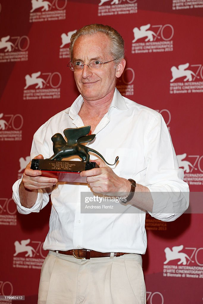Director Uberto Pasolini poses with the Orizzonti Award for Best Director he received for his movie 'Still Life' as he attends the Award Winners Photocall during the 70th Venice International Film Festival at Palazzo del Casino on September 7, 2013 in Venice, Italy.