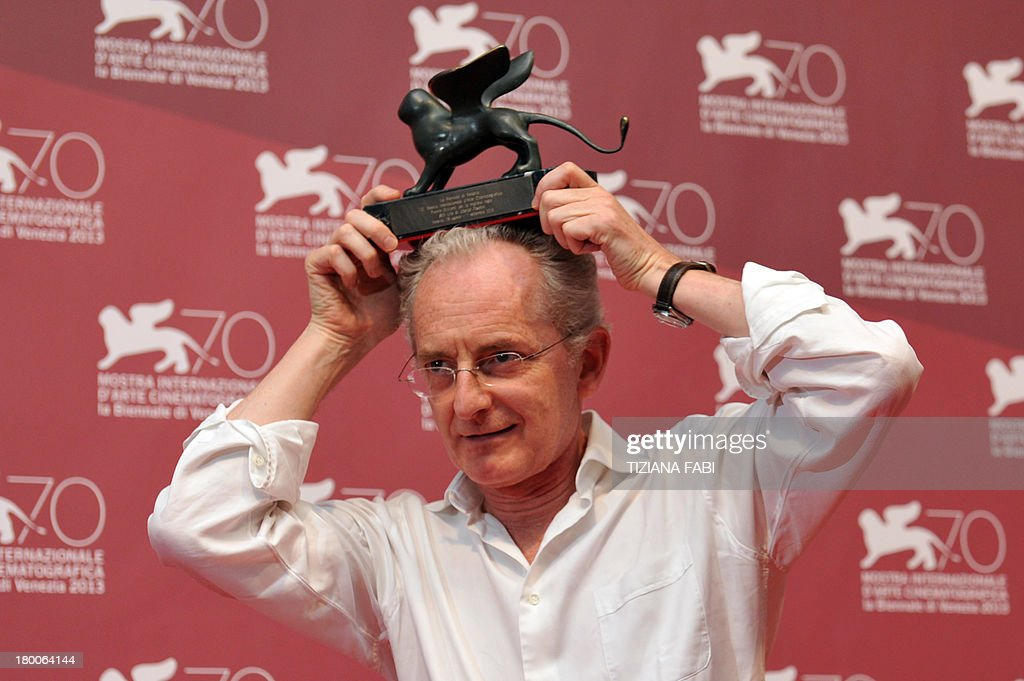Director Uberto Pasolini poses with the Orizzonti Award for Best Director he received for his movie 'Still Life' during a photocall at the award ceremony of the 70th Venice Film Festival on September 7, 2013 at Venice Lido.