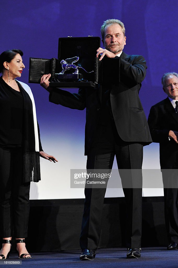 Director <a gi-track='captionPersonalityLinkClicked' href=/galleries/search?phrase=Ulrich+Seidl&family=editorial&specificpeople=4297039 ng-click='$event.stopPropagation()'>Ulrich Seidl</a> holds the Silver Lion award, which was mistakenly given to him as it's actually for Paul Thomas Anderson, on stage during the Award Ceremony at the 69th Venice Film Festival at the Palazzo del Cinema on September 8, 2012 in Venice, Italy.