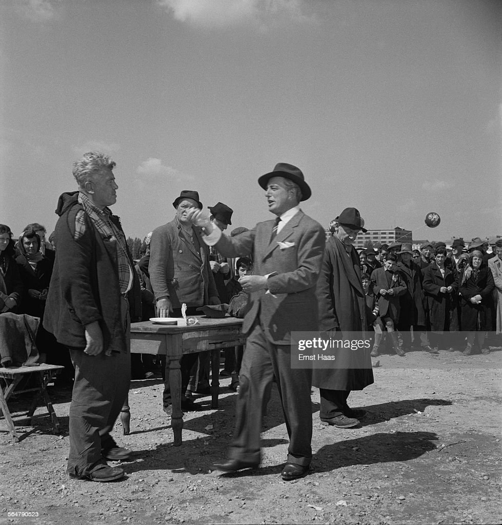 Director Vittorio De Sica (1901 - 1974) with boxer and actor Erminio Spalla (1897 - 1971) on the set of the film 'Miracolo a Milano' ('Miracle in Milan') in Italy, 1951.