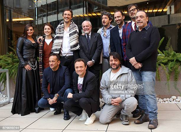 Director Volfango De Biasi and producer Aurelio De Laurentiis pose with cast during a photocall for 'Natale A Londra Dio Salvi La Regina' at Visconti...
