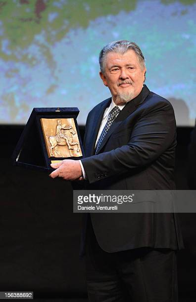 Director Walter Hill with his Maverick Award onstage ahead of the 'Bullets To The Head' Premiere during the 7th Rome Film Festival at the Auditorium...