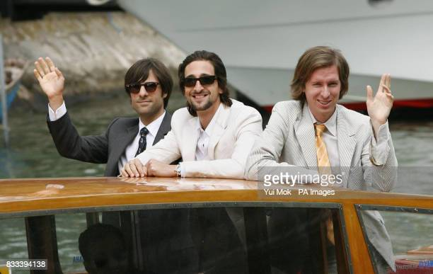 Director Wes Anderson Adrien Brody and cowriter Roman Coppola arrive by boat to attend a photocall for the film 'The Darjeeling Limited' at the...