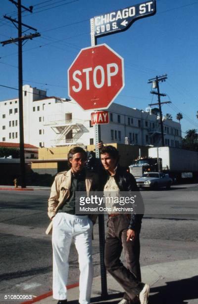 Director William Friedkin stands with William Petersen on a street corner for the MGM movie 'To Live and Die in LA' circa 1985