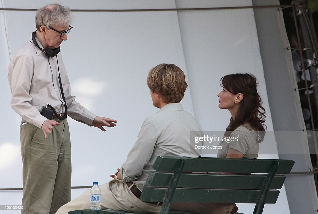 Director Woddy Allen speaks with actors Carla Bruni Sarkozy and Owen Wilson during the filming of 'Midnight in Paris' directed by Woody Allen on July...