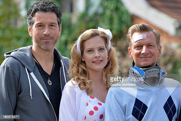 Director Wolfgang Groos and actors Diana Amft and Michael Kessler pose during a photocall on set of 'Die Vampirschwestern 2' at Haus Tepes on...