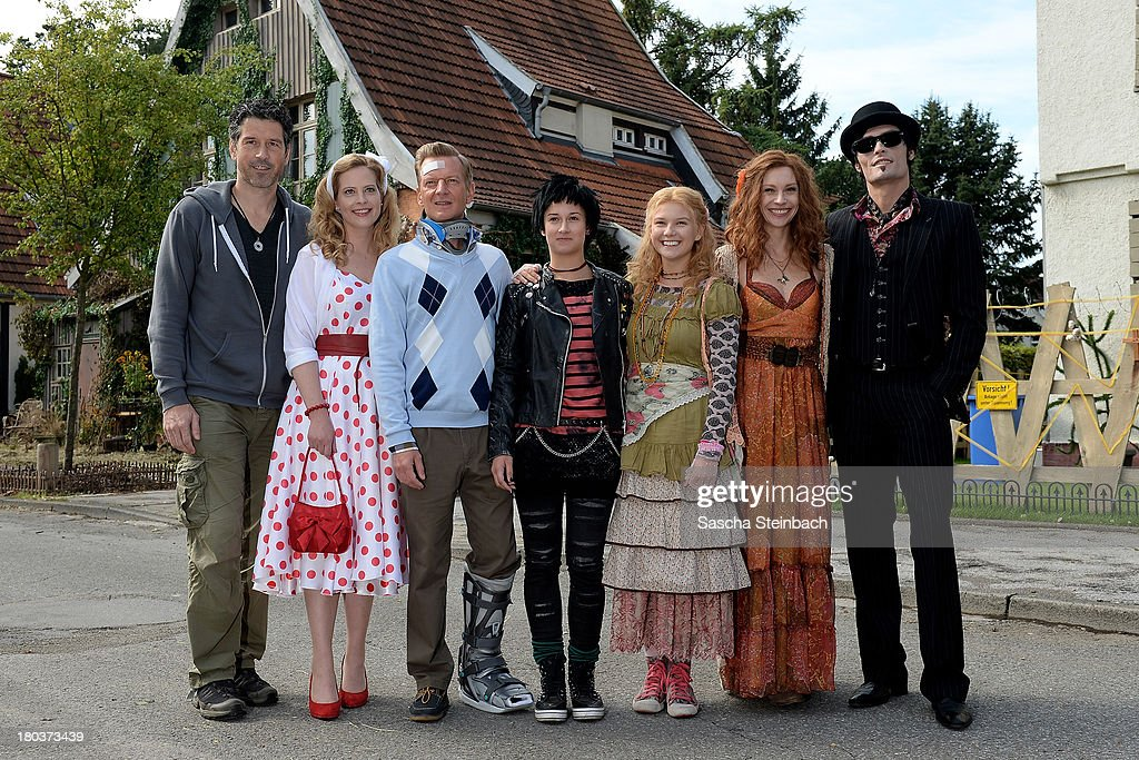 Director Wolfgang Groos and actors Diana Amft, Michael Kessler, Laura Roge, Marta Martin, Christiane Paul and Stipe Erceg pose during a photocall on set of 'Die Vampirschwestern 2' at Haus Tepes on September 12, 2013 in Herne, Germany.