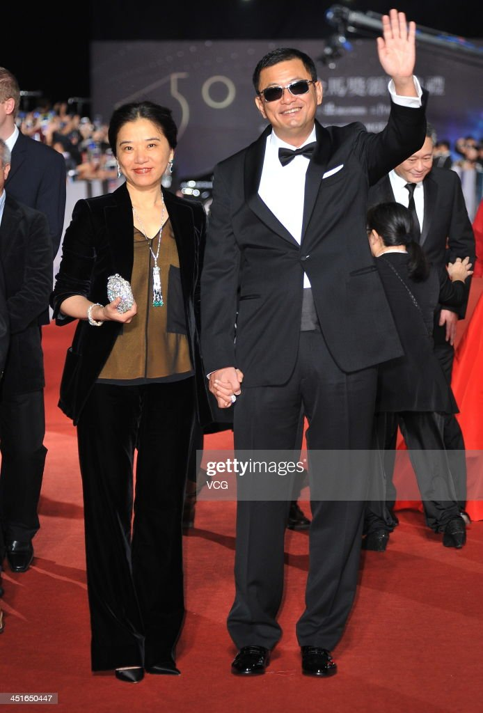 Director Wong Kar-wai and his wife arrive on the red carpet of the 50th Golden Horse Awards at Sun Yat-sen Memorial Hall on November 23, 2013 in Taipei, Taiwan.