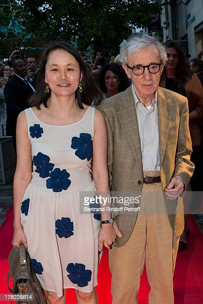 Director Woody Allen and his wife SoonYi Previn arrive to the Paris premiere of 'Blue Jasmine' at UGC Cine Cite Bercy on August 27 2013 in Paris...