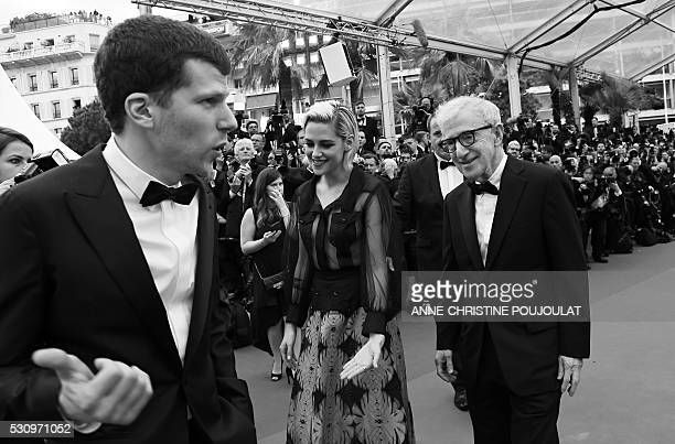 US director Woody Allen arrives on May 11 2016 with US actors Jesse Eisenberg and Kristen Stewart for the screening of the film 'Cafe Society' during...