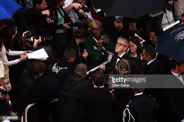 Director Woody Allen signs autographs for fans as arrives at the premiere for the film 'Vicky Cristina Barcelona' at the Palais des Festivals during...