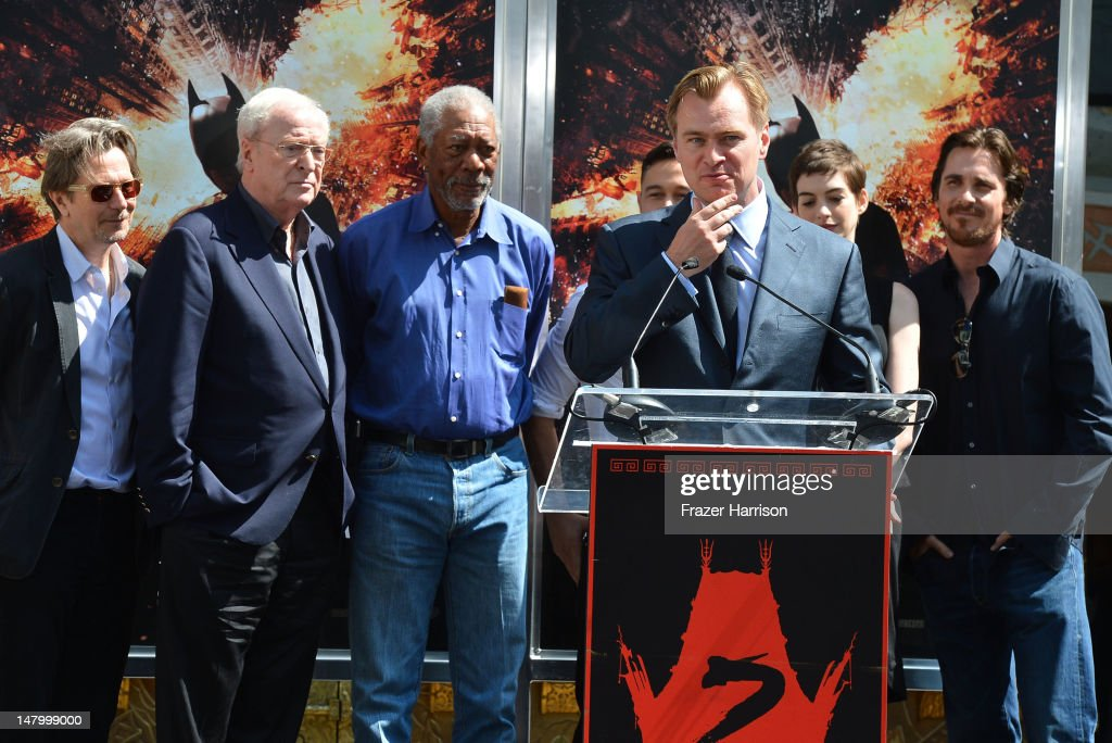 Director, Writer, Producer Christopher Nolan, who was honored with Hand and Footprint Ceremony at Grauman's Chinese Theatre watched on by (L-R) <a gi-track='captionPersonalityLinkClicked' href=/galleries/search?phrase=Gary+Oldman&family=editorial&specificpeople=213839 ng-click='$event.stopPropagation()'>Gary Oldman</a>, <a gi-track='captionPersonalityLinkClicked' href=/galleries/search?phrase=Michael+Caine+-+Actor&family=editorial&specificpeople=159746 ng-click='$event.stopPropagation()'>Michael Caine</a>, <a gi-track='captionPersonalityLinkClicked' href=/galleries/search?phrase=Morgan+Freeman&family=editorial&specificpeople=169833 ng-click='$event.stopPropagation()'>Morgan Freeman</a>, <a gi-track='captionPersonalityLinkClicked' href=/galleries/search?phrase=Joseph+Gordon-Levitt&family=editorial&specificpeople=213632 ng-click='$event.stopPropagation()'>Joseph Gordon-Levitt</a>, <a gi-track='captionPersonalityLinkClicked' href=/galleries/search?phrase=Anne+Hathaway+-+Actress&family=editorial&specificpeople=11647173 ng-click='$event.stopPropagation()'>Anne Hathaway</a> and <a gi-track='captionPersonalityLinkClicked' href=/galleries/search?phrase=Christian+Bale&family=editorial&specificpeople=239518 ng-click='$event.stopPropagation()'>Christian Bale</a>,on July 7, 2012 in Hollywood, California.