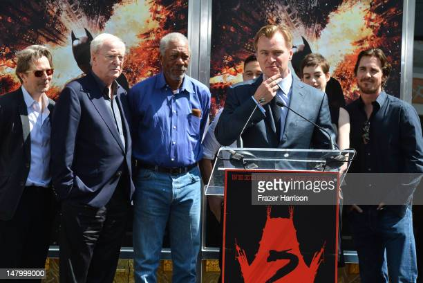Director Writer Producer Christopher Nolan who was honored with Hand and Footprint Ceremony at Grauman's Chinese Theatre watched on by Gary Oldman...
