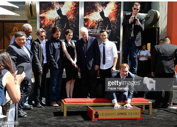 Director Writer Producer Christopher Nolan who was honored with Hand and Footprint Ceremony at Grauman's Chinese Theatre watched on by Morgan...