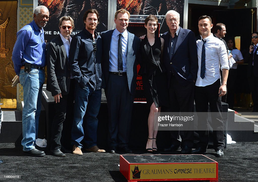 Director, Writer, Producer Christopher Nolan, (center) who was honored with Hand and Footprint Ceremony at Grauman's Chinese Theatre with (L-R) Morgan Freeman,Gary Oldman, Christian Bale, Anne Hathaway, Michael Caine, Joseph Gordon-Levitt,on July 7, 2012 in Hollywood, California.