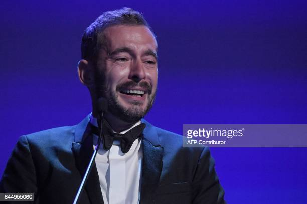 Director Xavier Legrand receives the Silver Lion for Best Director award with the movie 'Jusqu'à la Garde' during the award ceremony of the 74th...