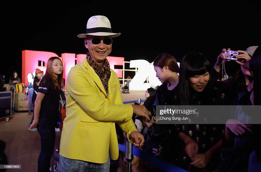 Director Yonfan attends the Hand printing event during the 16th Busan International Film Festival (BIFF) at Haeundae seashore on October 8, 2011 in Busan, South Korea. The biggest film festival in Asia showcases 307 films from 70 countries and runs from October 6-14.