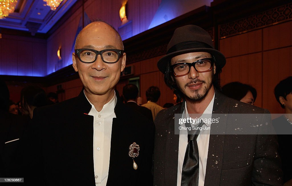 Director Yonfan poses with actor Odagiri Joe during the Opening ceremony party of the 16th Busan International Film Festival (BIFF) at Grand Hotel on October 6, 2011 in Busan, South Korea. The biggest film festival in Asia showcases 307 films from 70 countries and runs from October 6-14.