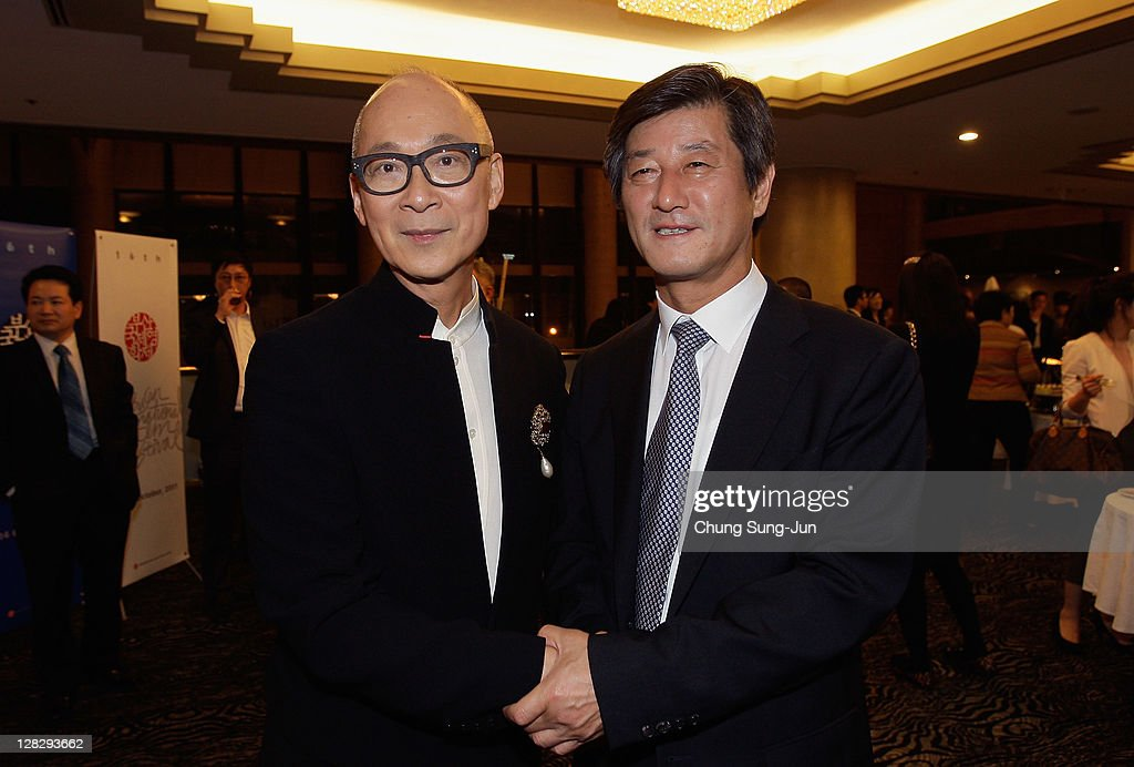 Director Yonfan poses with festival director Lee Yong-Kwan during the Opening ceremony party of the 16th Busan International Film Festival (BIFF) at Grand Hotel on October 6, 2011 in Busan, South Korea. The biggest film festival in Asia showcases 307 films from 70 countries and runs from October 6-14.